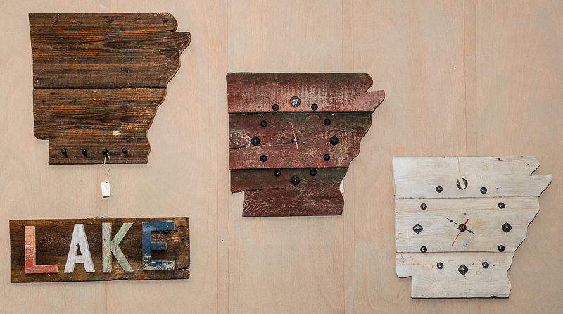 Rustic wooden wall hangings by Shane Benton.