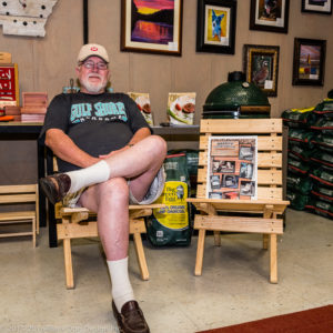 Harry McMann enjoying one of his custom chairs at Black Dog Design.